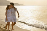 Happy young couple together on the beach — Stock Photo