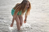 Young happy woman running on beach — Stock Photo
