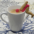 Cup of coffee with cookies shaped swimmers - Stock Photo