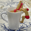 图库照片: Cup of coffee with cookies shaped swimmers