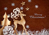 Christmas background with gold deer and snowflake — Stock Photo