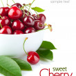 Fresh cherry berries with green leaf - 