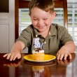 Young boy blowing out his birthday candle — Stock Photo #10792369