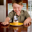 Royalty-Free Stock Photo: Young boy blowing out his birthday candle