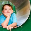 Cute young child boy or kid playing in tunnel on playground. — Стоковое фото