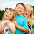 Portrait of three children playing at park — Stock Photo #10813603