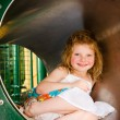 Royalty-Free Stock Photo: Cute little girl playing in tunnel on playground