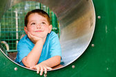 Cute young child boy or kid playing in tunnel on playground. — Stock Photo