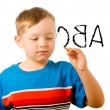 Education back to school concept with child writing alphabet — Stock Photo