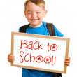 "Stock Photo: Education concept with child holding sign that reads ""back to school"""