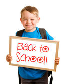 "Education concept with child holding sign that reads ""back to school"" — Stock Photo"