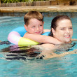 Mother and son swimming together while on vacation — Stockfoto
