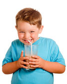 Happy smiling child drinking chocolate milk — Stock Photo