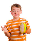 Happy smiling child playing tambourine isolated on white — Stock Photo