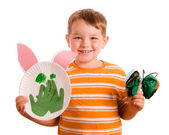 Preschool education concept with child showing off his art projects isolated on white — Stock Photo