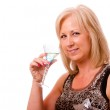 Portrait of pretty middle-aged woman in her 40s with cocktail and dressed for party or night out on the town — Stock Photo