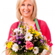 Portrait of smiling happy florist with green apron isolated on white — Stock Photo