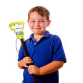 Child lacrosse player with his stick and ball isolated on white — Stock Photo