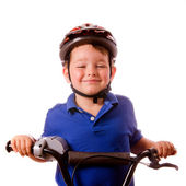 Happy child riding his bike isolated on white — Стоковое фото