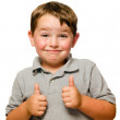 Portrait of confident child showing thumbs up isolated one white — Stock Photo #11284205