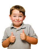 Portrait of confident child showing thumbs up isolated one white — Stock Photo