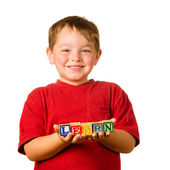 "Preschool education concept with child holding blocks that spell out ""learn"" — Stock Photo"