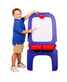 Child pointing at dry erase board with room for your text — Stock Photo