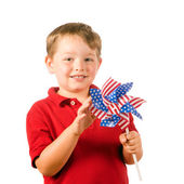 Child playing with American flag pinwheel to celebrate Independence Day on July Fourth isolated on white — Stock Photo