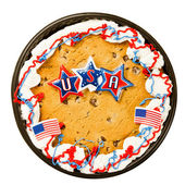 Big chocolate chip cookie decorated to celebrate Independence Day on July Fourth isolated on white — Stockfoto
