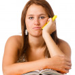 Bored unhappy teenage school girl studying with textbooks isolated on white — Stock Photo