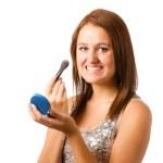 Teenage girl applying makeup or cosmetics isolated on white — Stock Photo #11527255