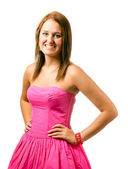 Portrait of happy smiling teenage girl in pink dress isolated on white — Stock Photo