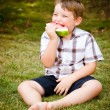Summer portrait of cute young child eating watermelon outdoors — Stock Photo