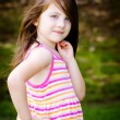 Outdoor portrait of cute young girl in park — Stock Photo