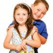 Portrait of two happy children isolated on white — Stock Photo