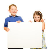 Portrait of children holding blank sign with room for text isolated on white — Stock Photo
