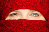 Winter concept with middle-aged woman wrapped up in red scarf — Stock Photo