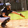 Teen girl playing softball in organized game — Stock Photo