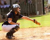 Teen girl playing softball in organized game — Stock Photo