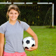 Portrait of teen girl soccer player on field — Stock Photo #12362354