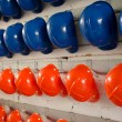 Blue and orange Helmets - Stock Photo