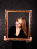 Woman With Gold Picture Frame — Stock Photo