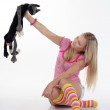 Young woman playing with toy cat — Stock Photo