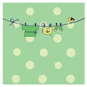 Baby clothes on clothesline — Stock Vector