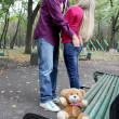 Couple in the love with the bear — Stock Photo