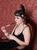 Retro woman smoking with the cigarette holder — Stock Photo