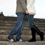 Feet of loving couple — Stock Photo