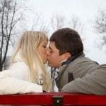 Loving couple on bench in autumn — Stock Photo