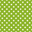 Seamless vector pattern with polka dots on fresh grass green background — Stock Vector