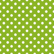 Stock Vector: Seamless vector pattern with polkdots on fresh grass green background